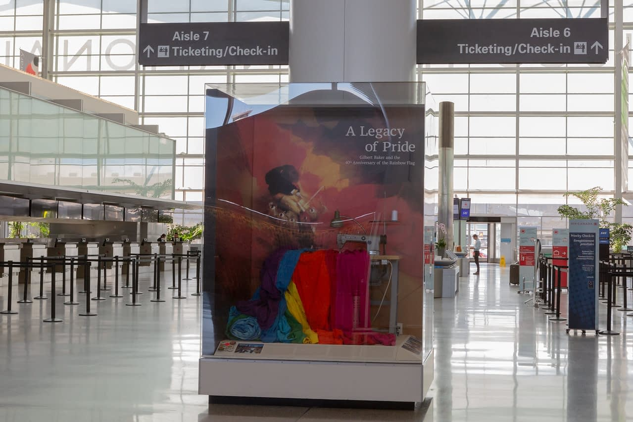 Display by the San Francisco Airport Museum honoring the late Gilbert Baker,  (co – creator of the Rainbow Flag)