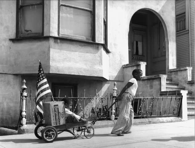 Boy and Flag, Hunter's Point, San Francisco, CA 1947